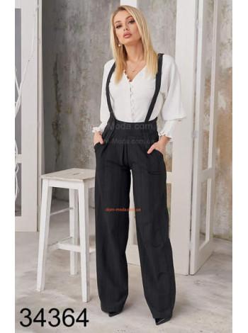Широкі жіночі брюки з підтяжками