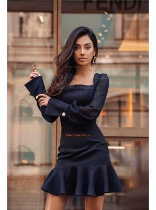 Коротка сукня з воланом внизу