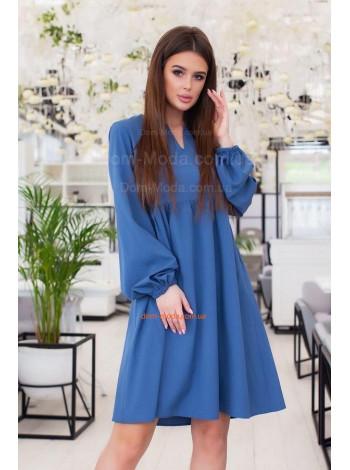 Женское платье свободного кроя с большим рукавом