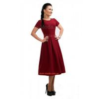 Жіноче однотонне нарядне плаття за коліно