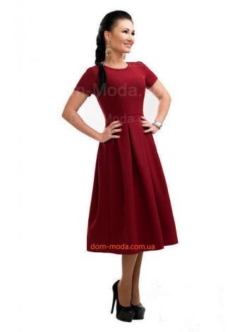 Женское однотонное нарядное платье за колено