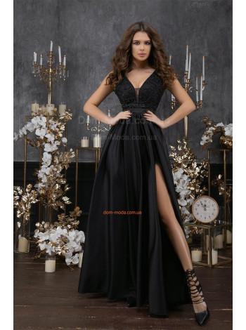 Женское черное вечернее платье в пол с глубоким вырезом