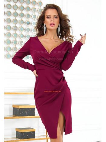 Сексуальна вечірня сукня з глибоким декольте
