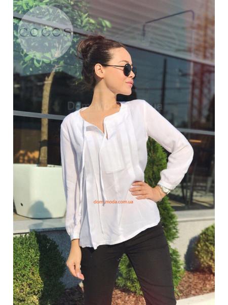 Женская блузка свободного кроя с длинным рукавом