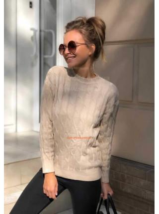Жіночий в'язаний светр з косами