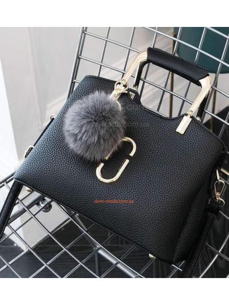 Невелика жіноча сумка з металевими ручками