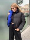 Двостороння жіноча куртка