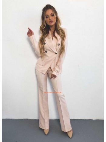 Стильний жіночий костюм з брюками кльош
