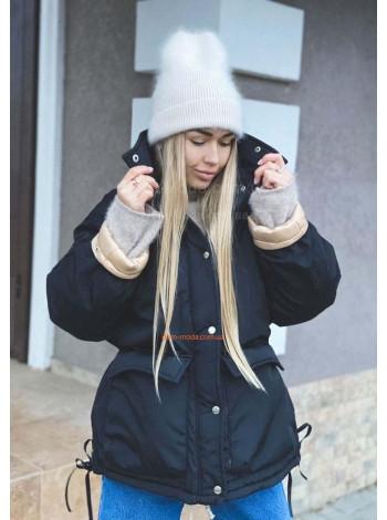 Однотонна жіноча зимова куртка вільного крою