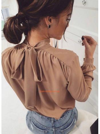 Блузка с бантом на спине