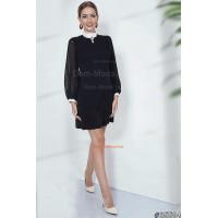 Стильне жіноче плаття з довгими об'ємними рукавами на манжетах