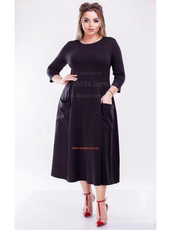 Стильне плаття міді із кишенями великого розміру