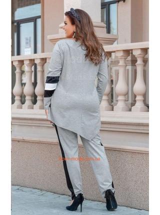 Модний жіночий костюм із тунікою для повних