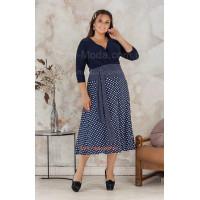 Красиве трикотажне плаття із глибоким декольте