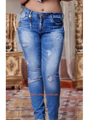 Жіночі модні джинси із потертостями великого розміру