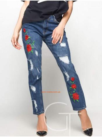 Стильні жіночі джинси із потертостями і яскравими квітами