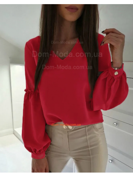 Модна жіноча блузка із об'ємними рукавами