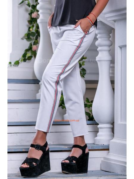 Модні укорочені штани з кишенями
