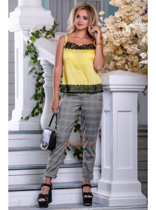 Жіночі штани в клітку на літо