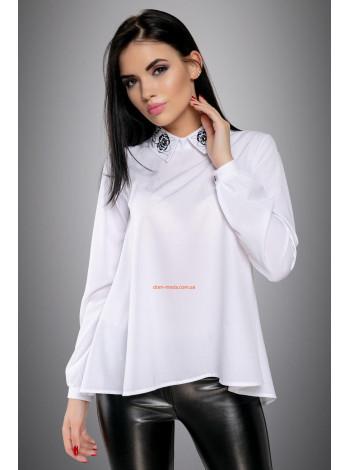 Блуза свободного кроя с пуговицами на спине