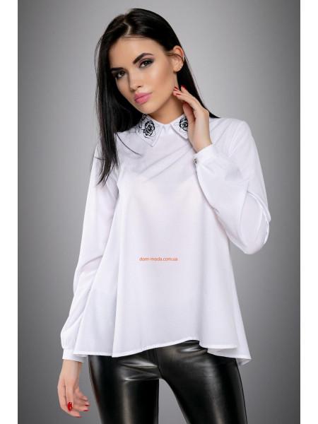 Блуза вільного крою із гудзиками на спині