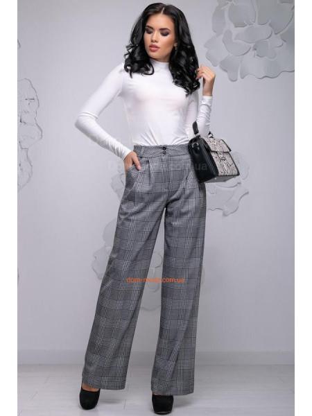 Женские брюки в клетку для стильной девушки