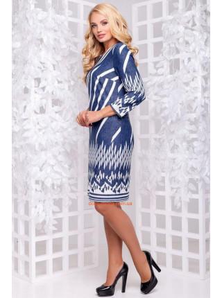 Плаття синього кольору із білим малюнком для повних