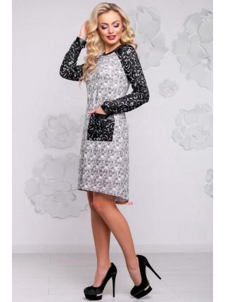 Стильное платье серого цвета с карманом