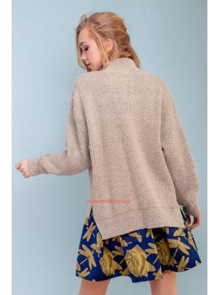 Стильний жіночий светр вільного крою