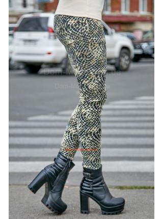 Модні жіночі трикотажні лосіни в зміїний принт
