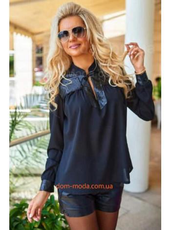 Женская блузка с кожаными вставками